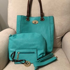 Teal shoulder purse with accessories.